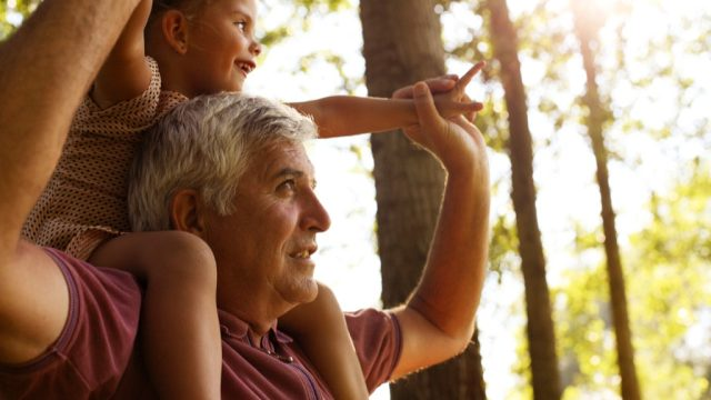 grandparent and grandchild in the woods