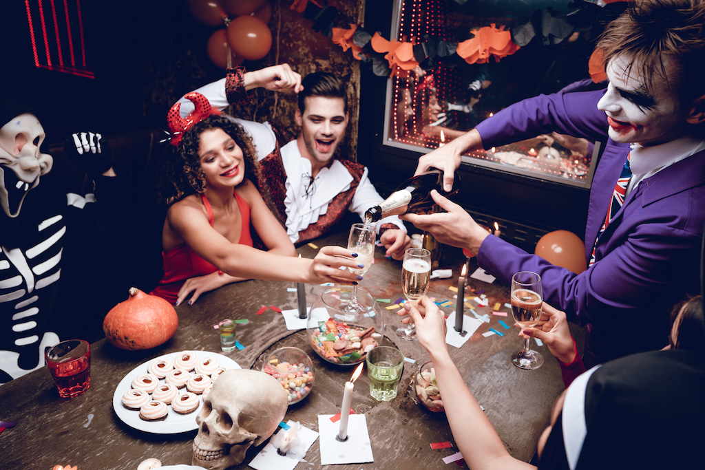 adults in costumes at a Halloween party