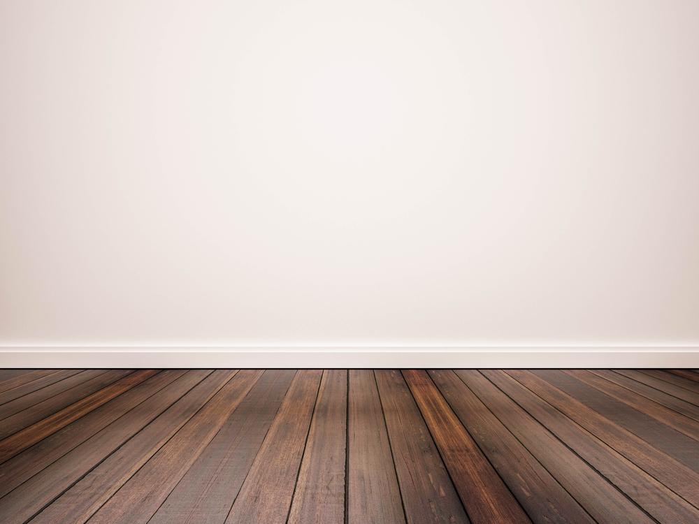 hardwood floors against white wall