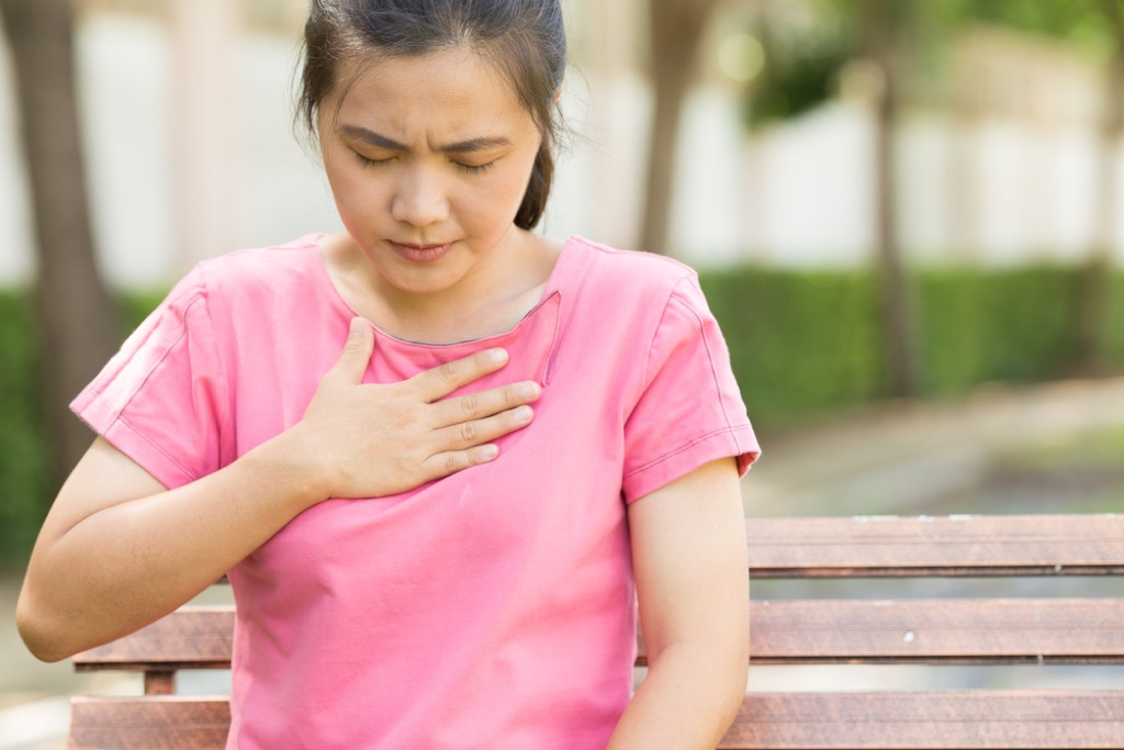 woman with hand over heart, ways you're damaging teeth