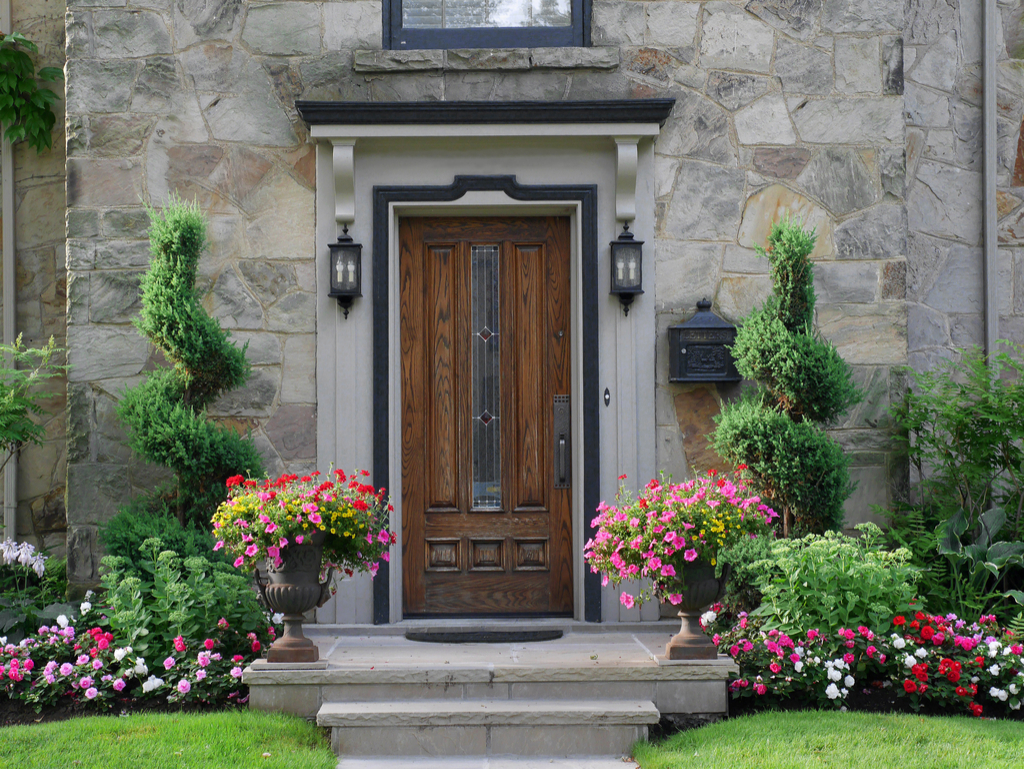 Home with Flowers Boosting Your Home's Curb Appeal