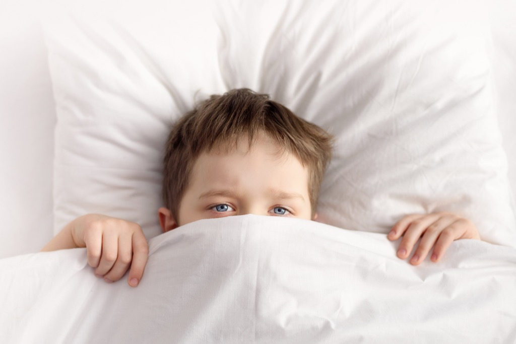 kid in bed, skills parents should teach kids