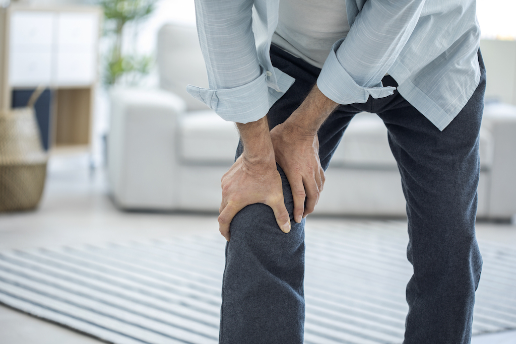 old elderly man suffering from knee pain