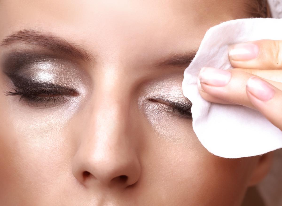 Woman using makeup removing wipe