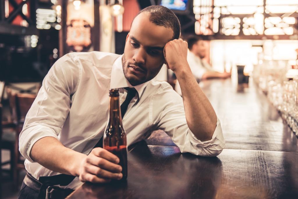 sad man sitting at the bar