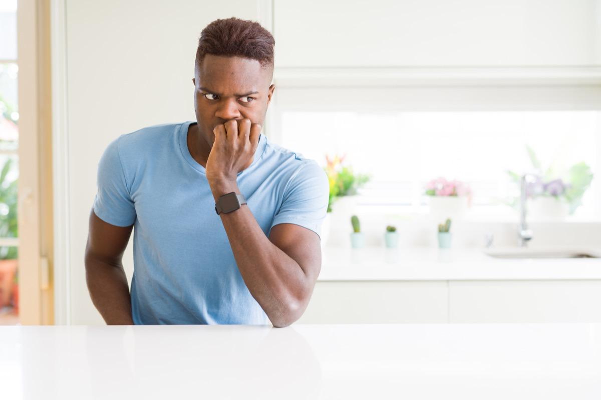 man biting his nails