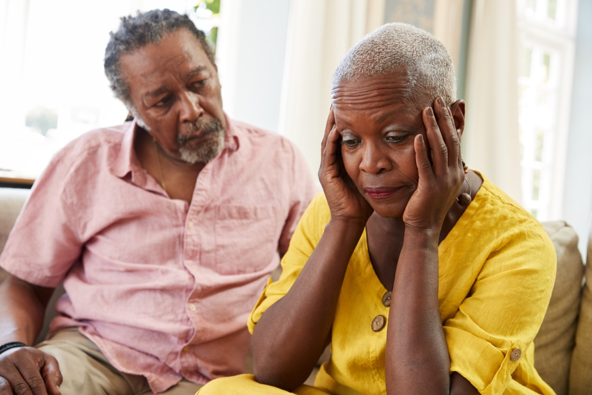 man comforting older woman with depression, contagious conditions