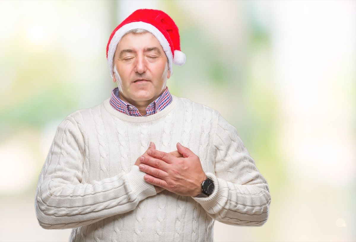 Older man holding his heart in pain on Christmas