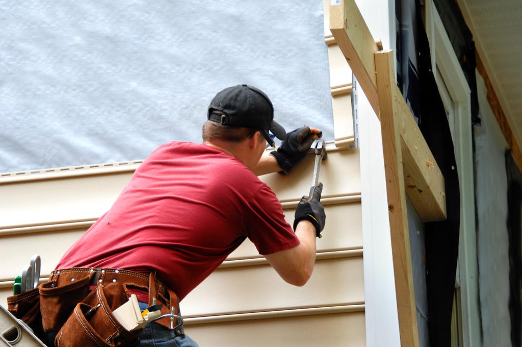 Man Installing Siding, home upgrades
