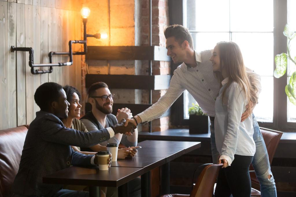Man Meeting Partner's Friends Signs Your Partner Misses Her Ex