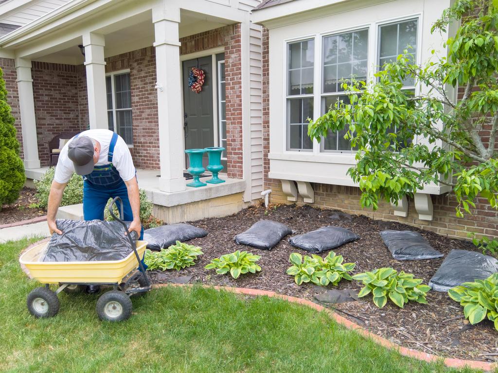 Man Putting Mulch in Yard home problems