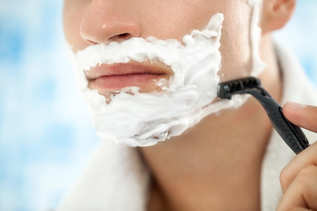 man shaving close up