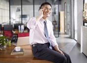 man talking on phone in office, office etiquette
