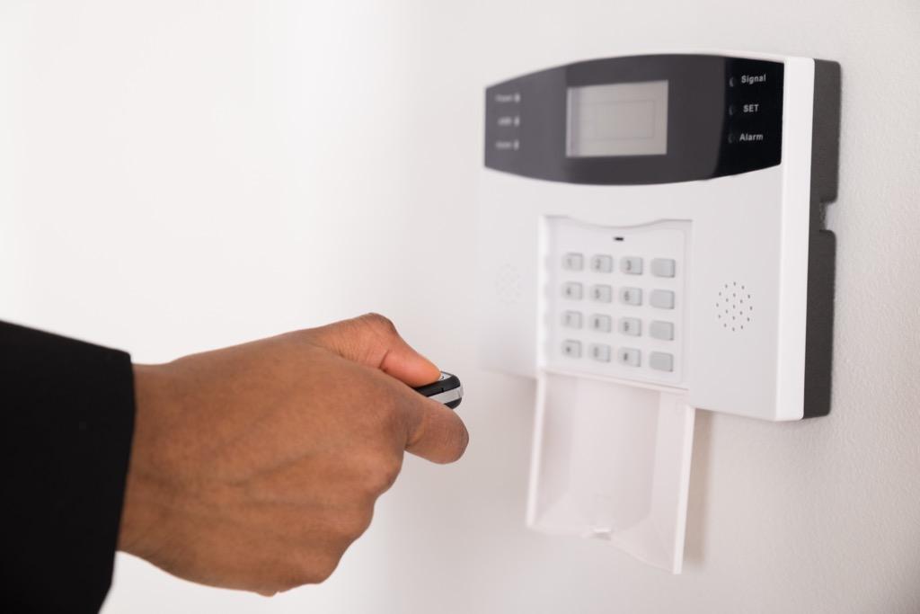 man using security alarm