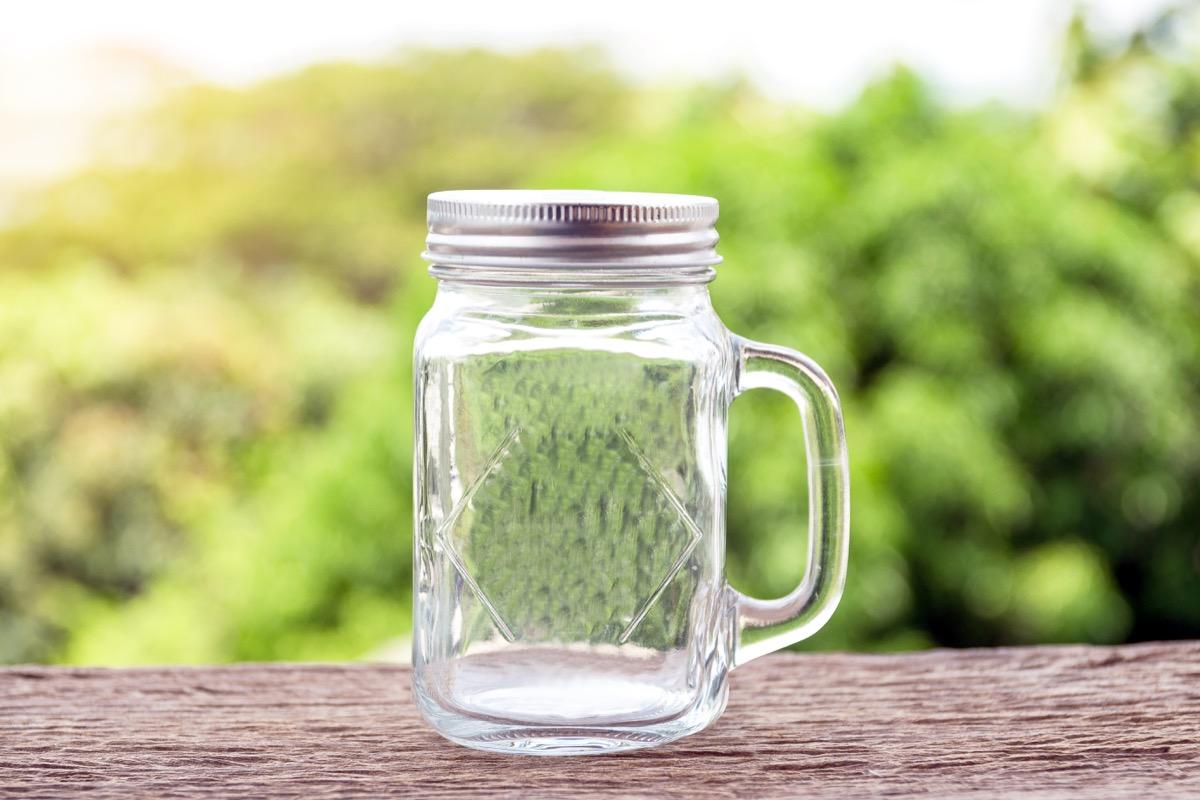empty mason jar sitting on a stoop