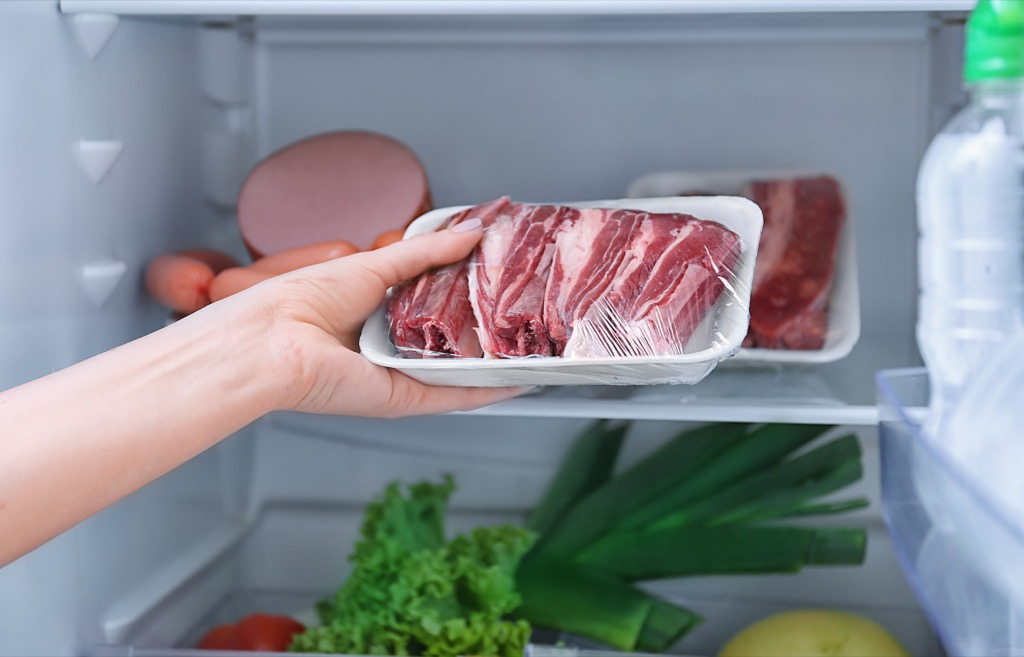 putting meat in the fridge