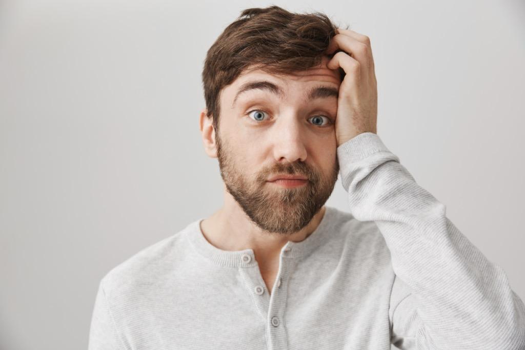 man with bushy eyebrows
