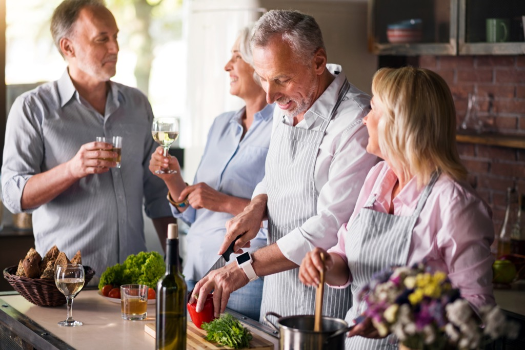 middle aged friends laughing in kitchen {Secrets to a Long Life}