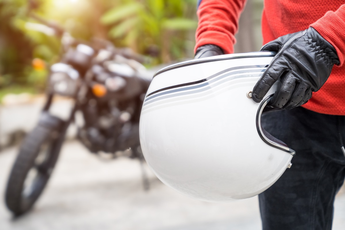 Man Taking off Motorcycle Helmet Alzheimer's Risk