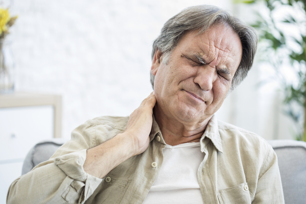older man with neck pain