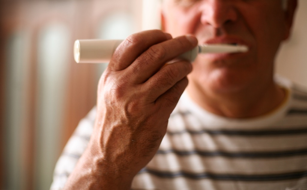 old man brushing teeth earliest signs of alzheimer's