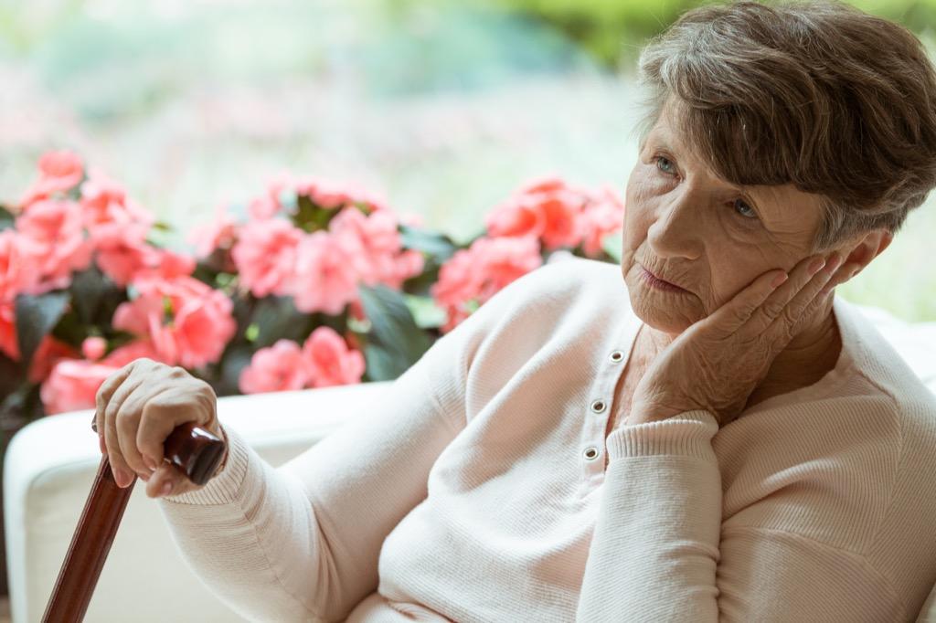 old woman feeling sad