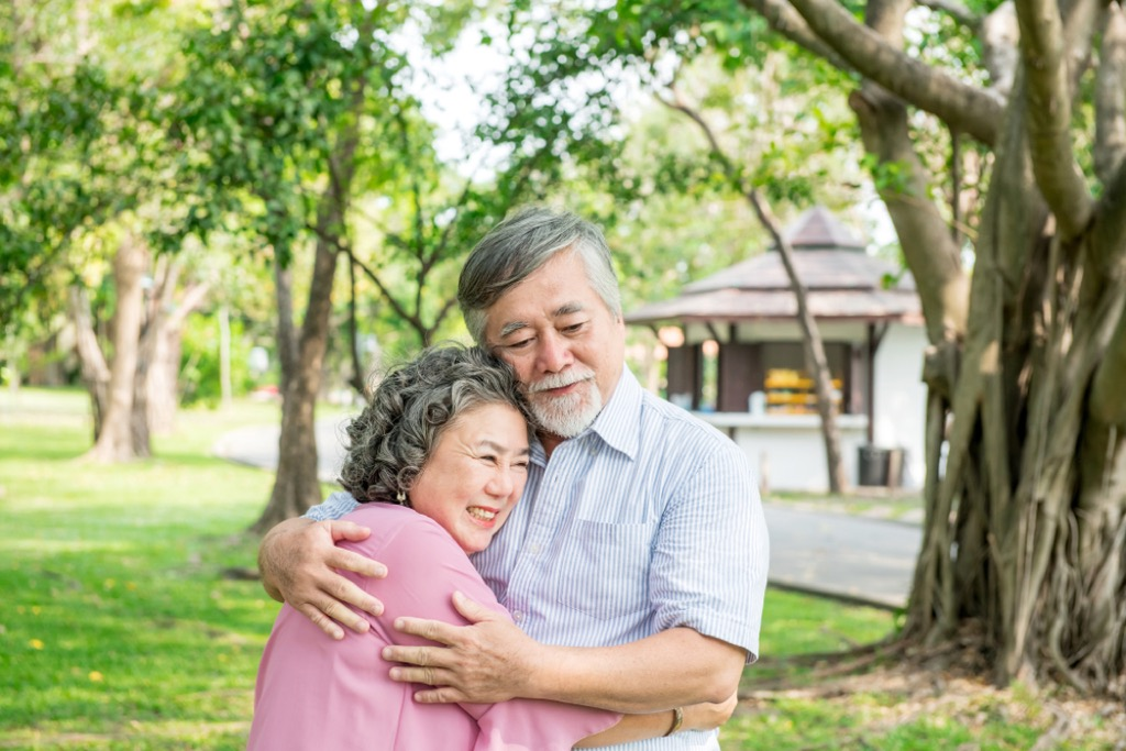 older couple hugging outdoors, better wife after 40