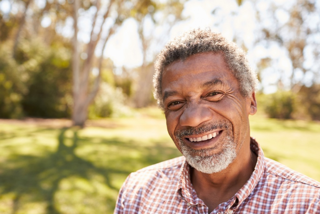 man with gray hair outdoors, look better after 40
