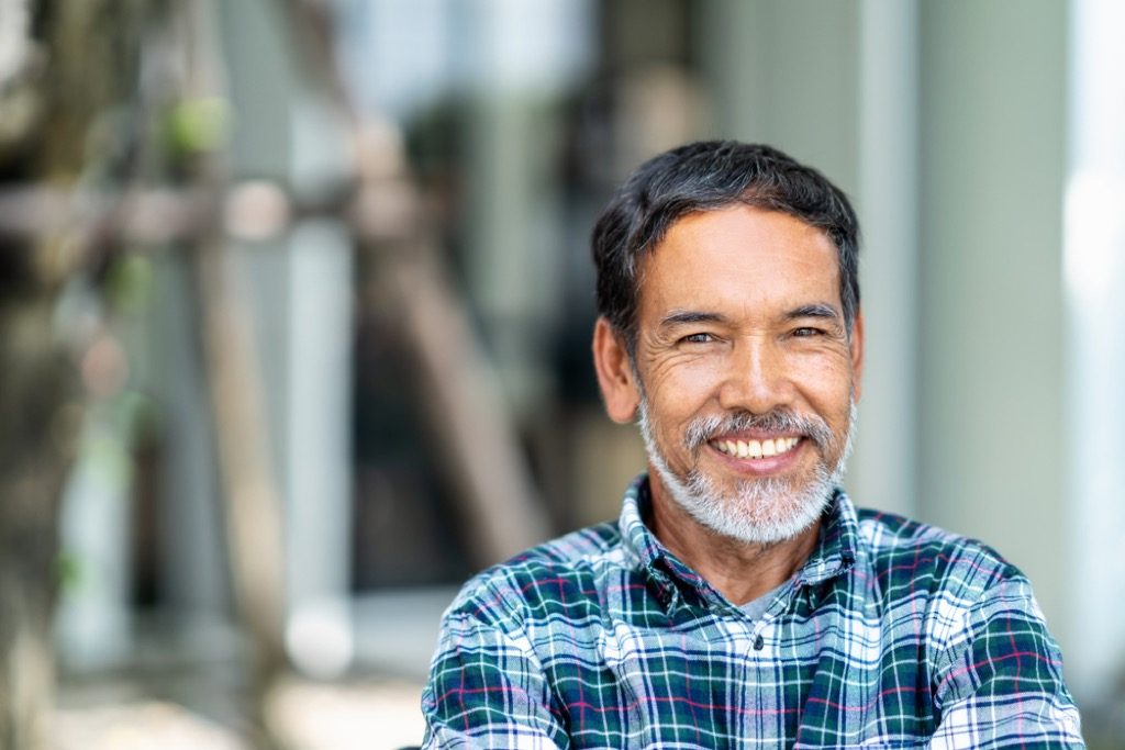 older man smiling outdoors, look better after 40