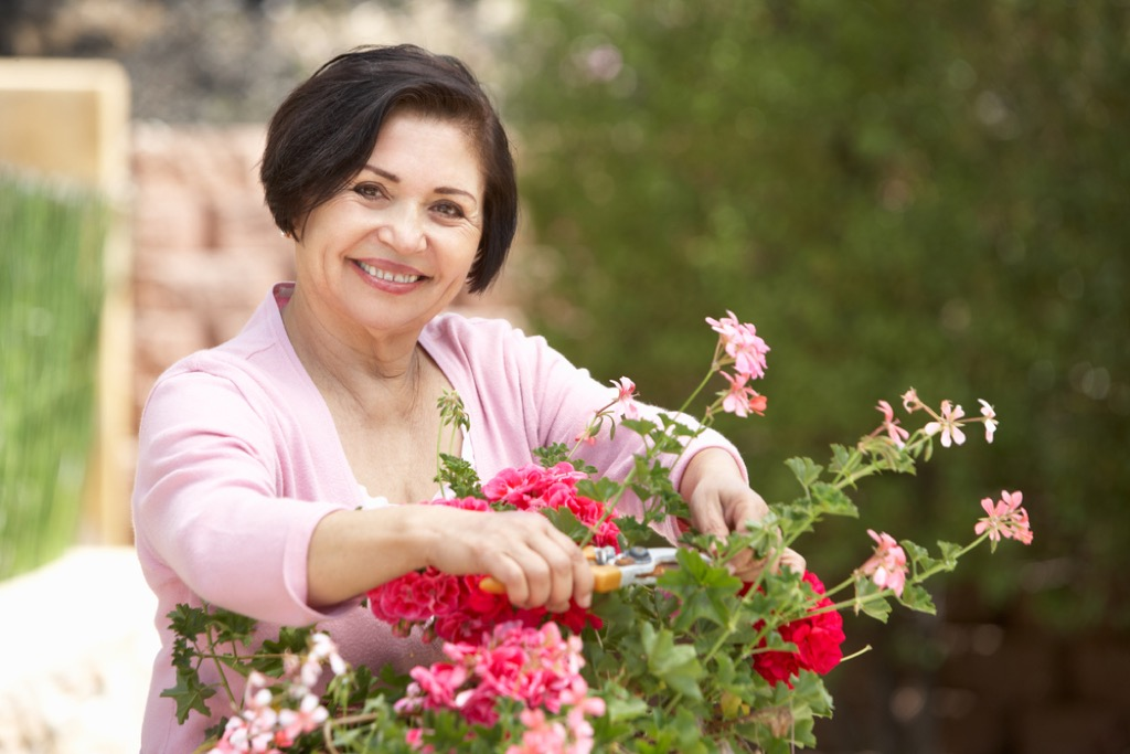woman with flowers eco-friendly habits