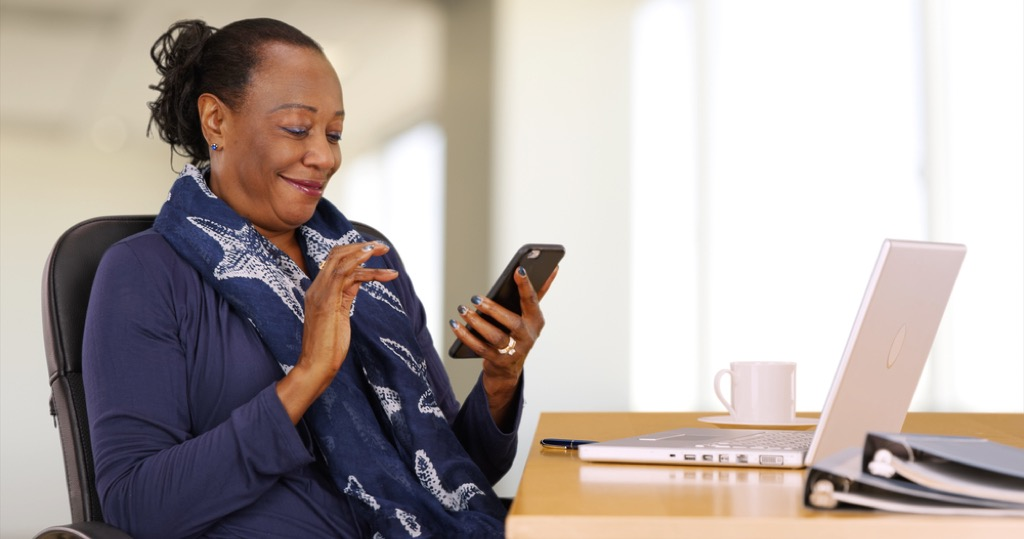 woman on phone how to make friends after 50