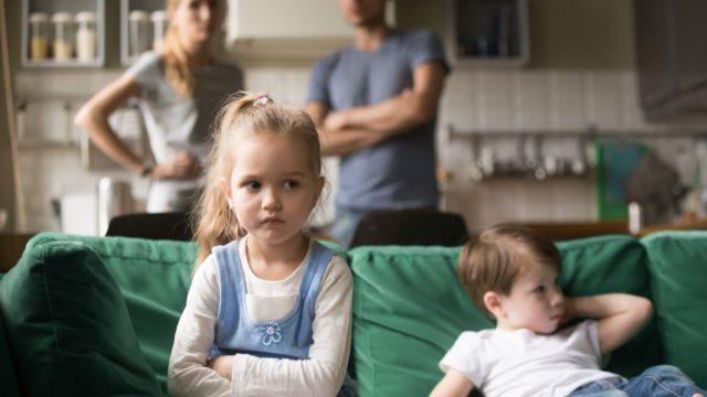 children sitting on couch, parent divorce