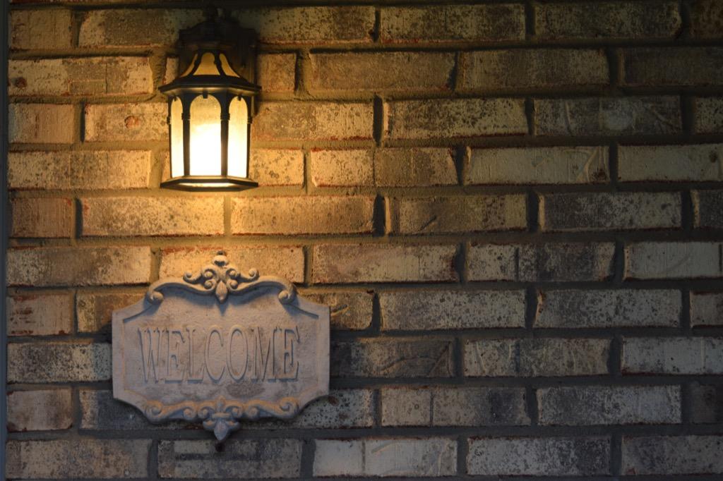 porch light against brick wall