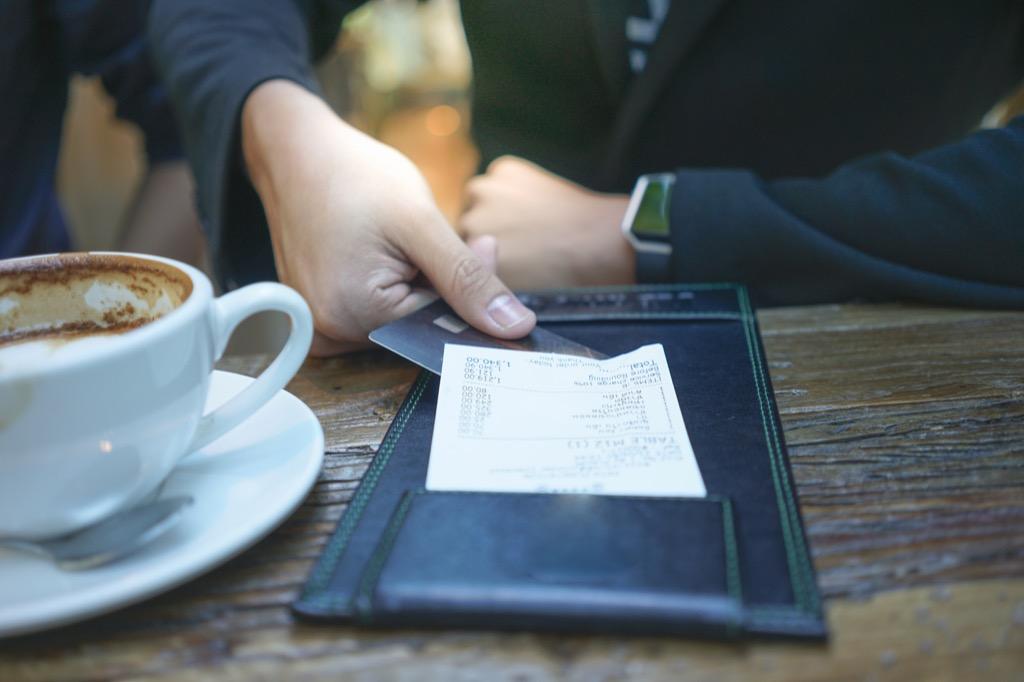man paying his check at a restaurant