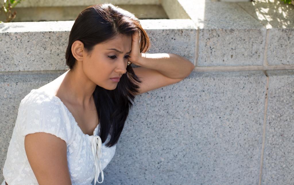 sad woman thinking self-care tips