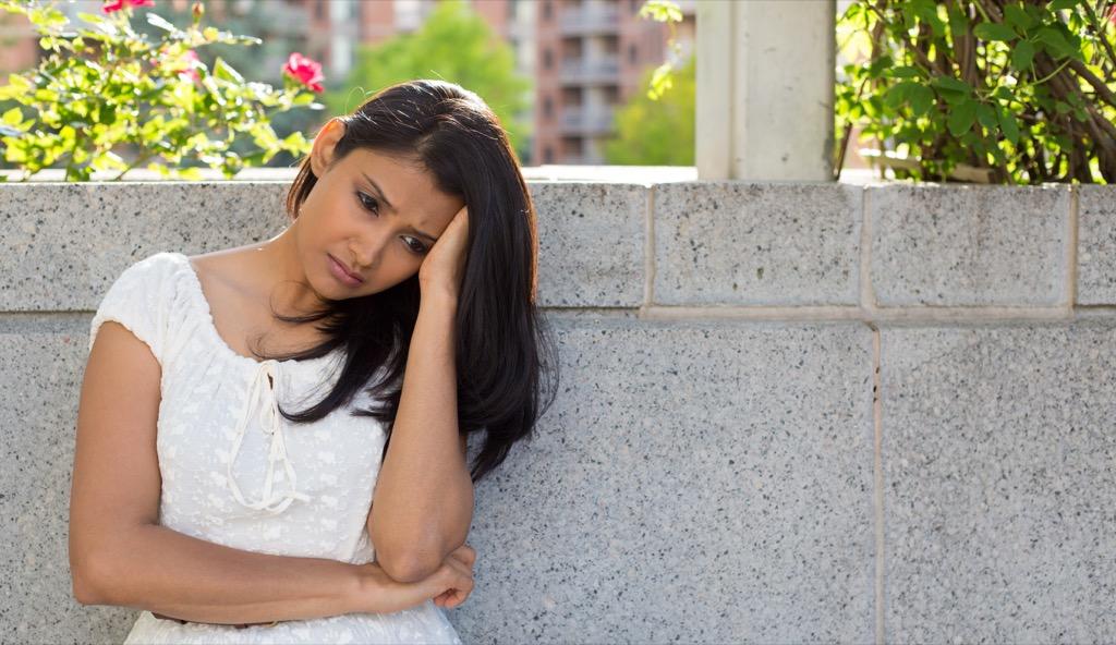 sad woman sitting outdoors, parent divorce
