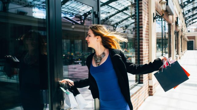 Woman shopper runs to store to save money on clothes