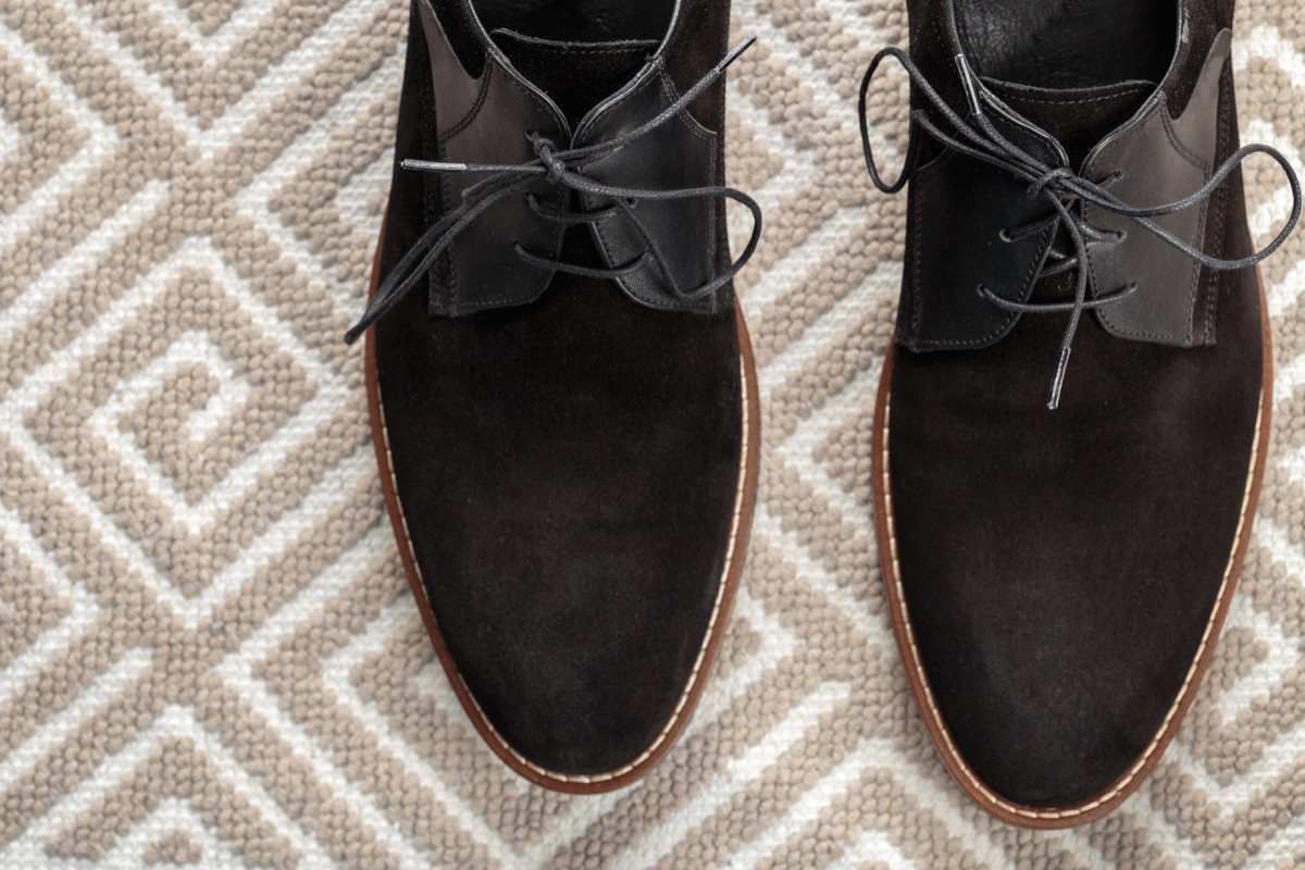 suede shoes on a patterned rug