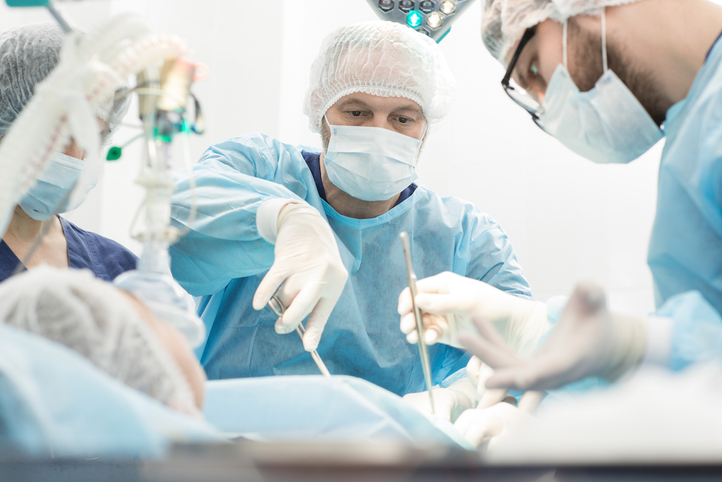doctors in the hospital performing surgery