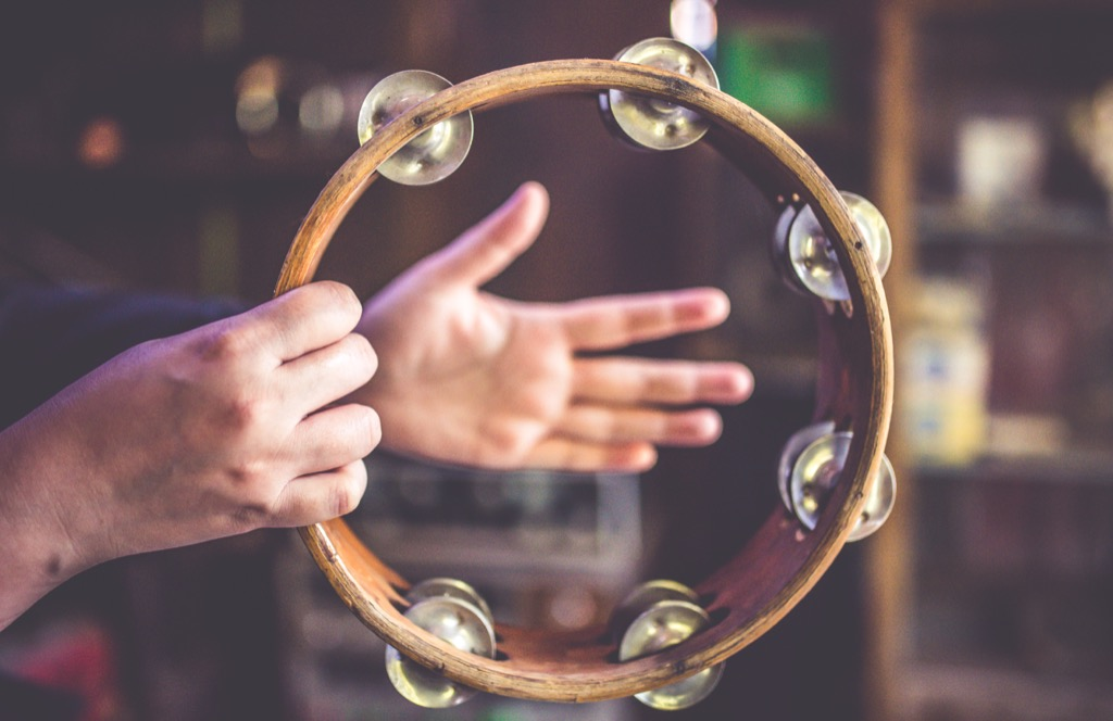person playing a tambourine