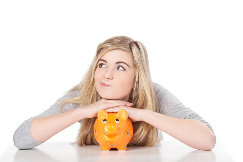 teen with piggy bank