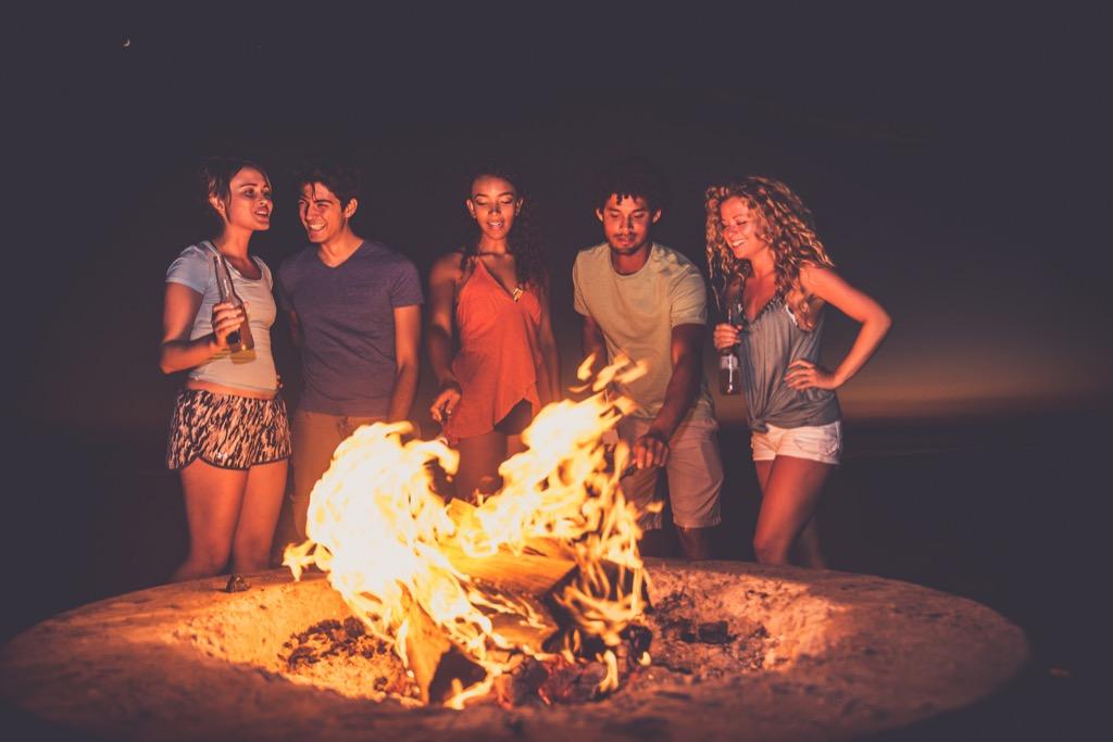 teens at a campfire