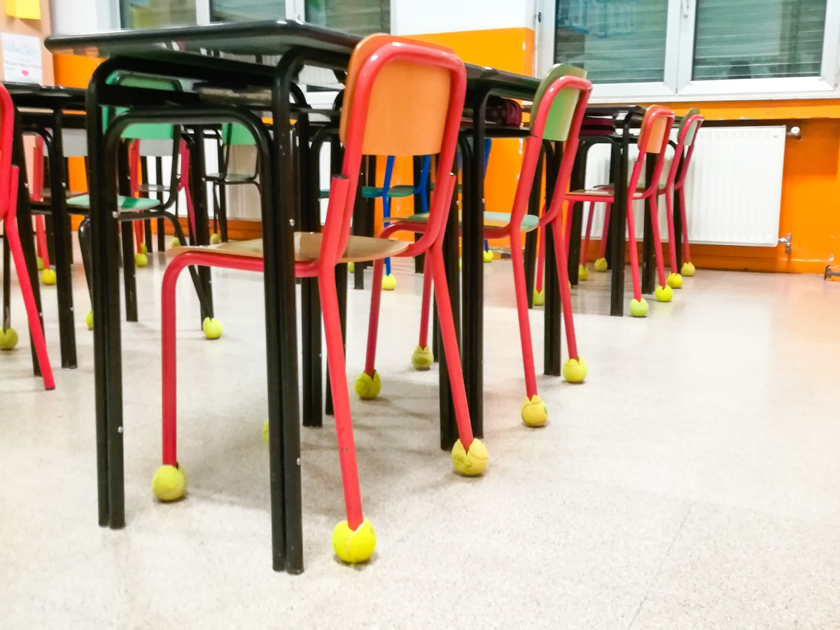 Classroom chairs in a row with tennis ball like bumpers