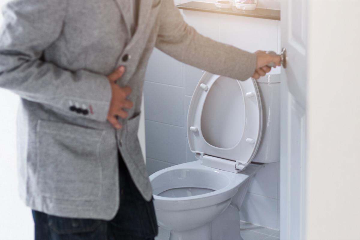 Man leaving toilet uncomfortable