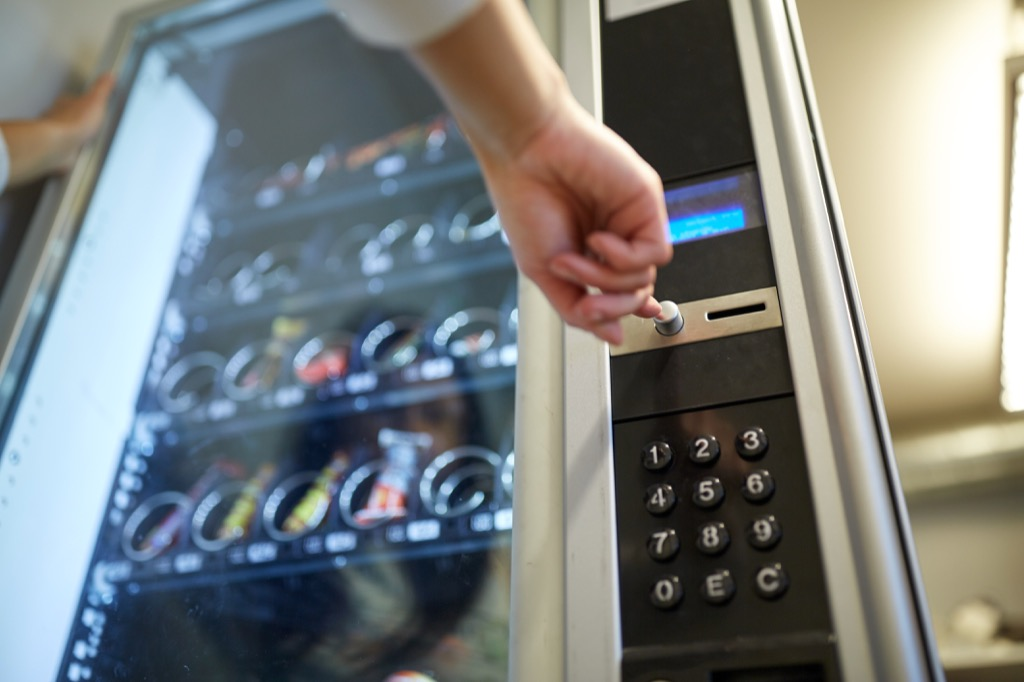 hand pointing to a vending machine