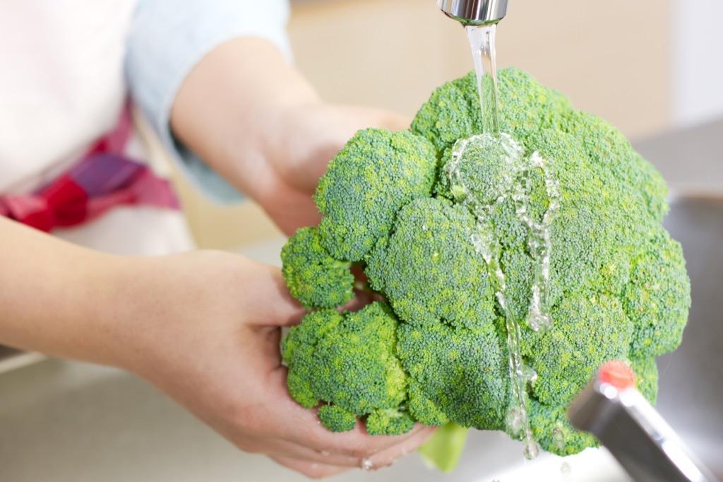 washing broccoli in sink