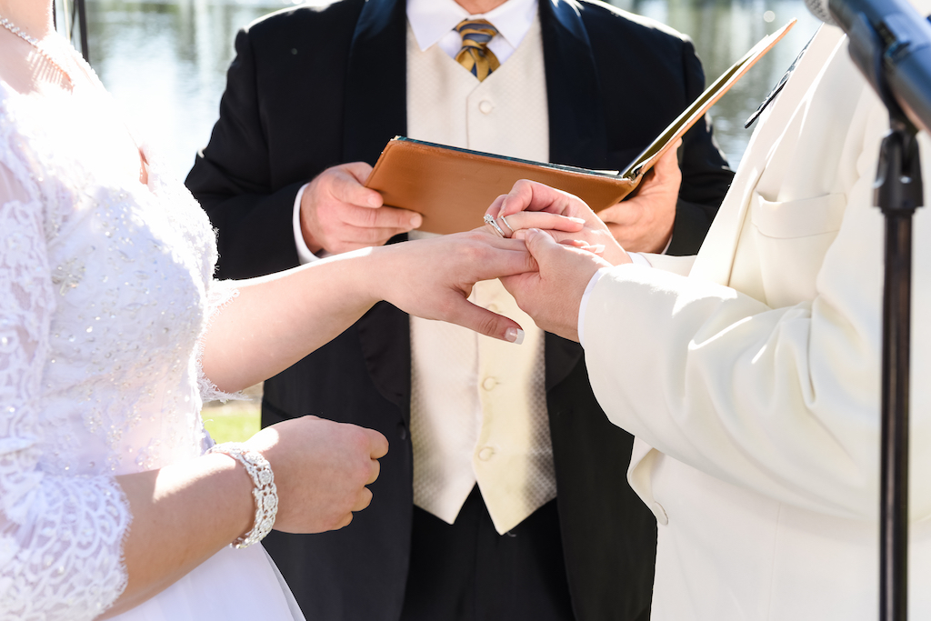 exchanging rings at a wedding ceremony