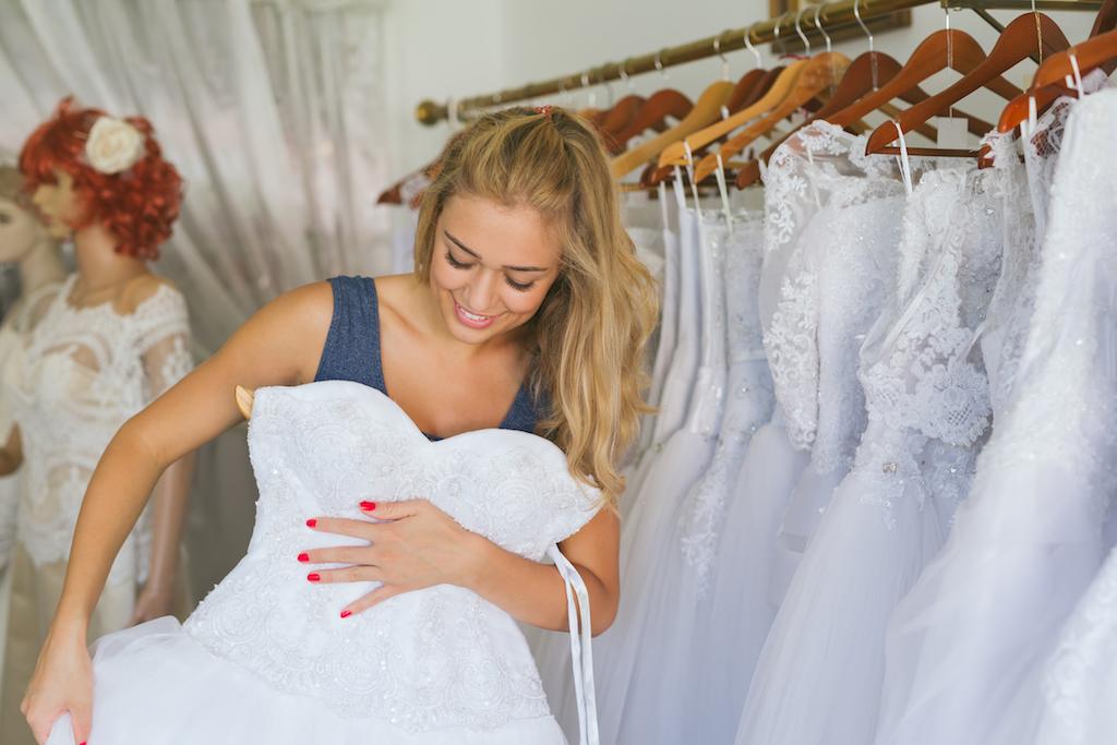 woman shopping for a wedding dress, wedding planner secrets