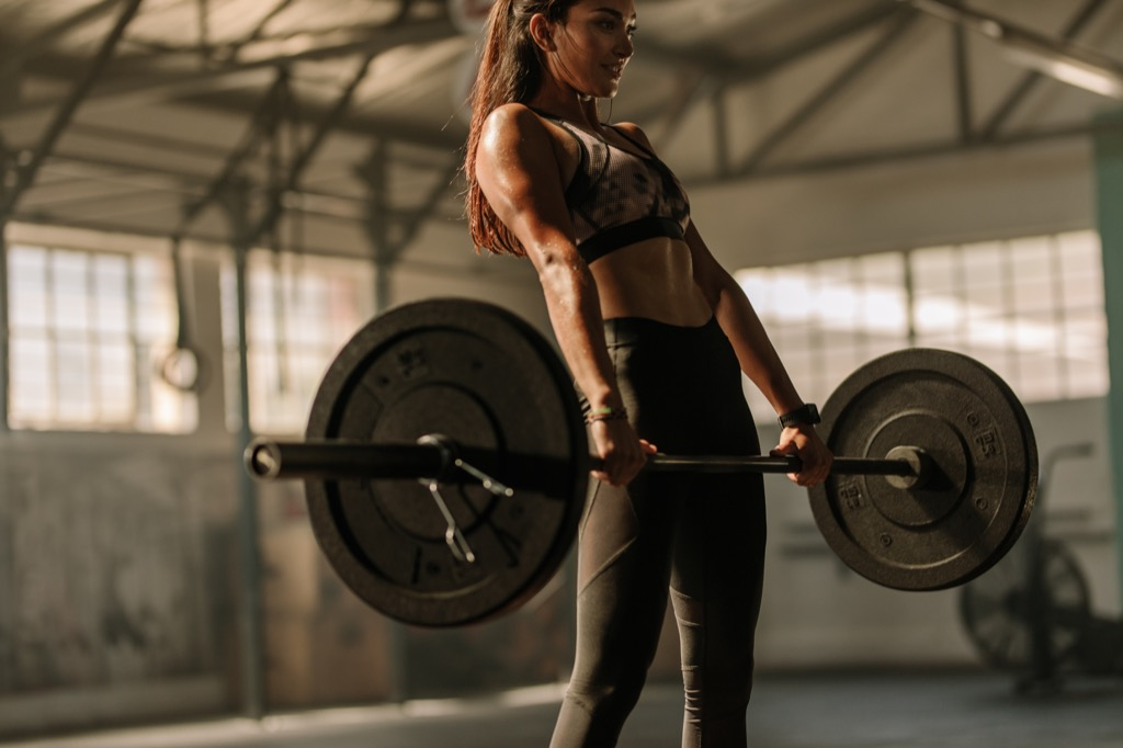 woman weightlifting at the gym