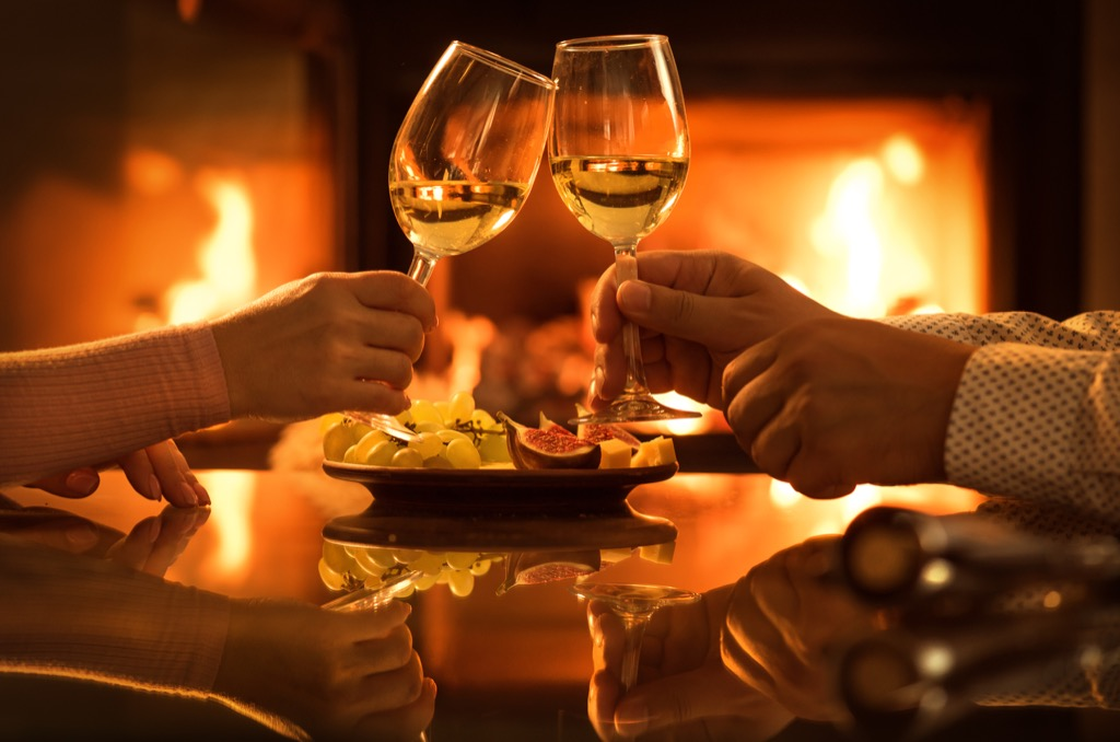 clinking glasses and eating by the fireplace, smart person habits